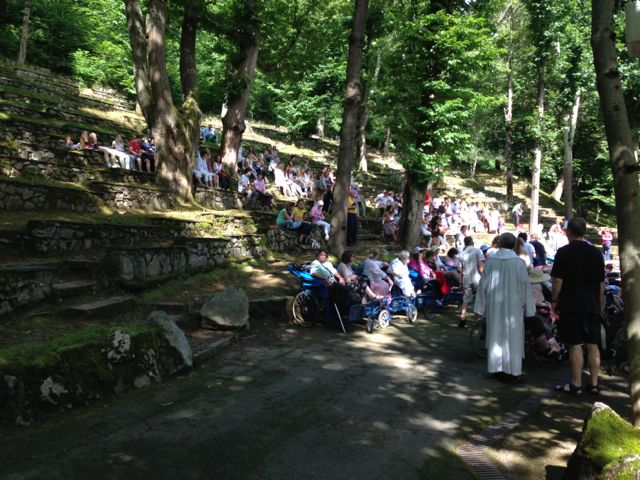 Lourdes, pilgrims and angels
